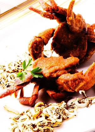 Nécoras en salsa con arroz salvaje frito
