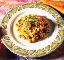 Arroz con verduras y menudillos de pollo