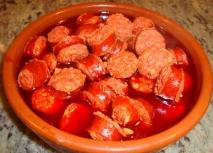 Chorizos a la sidra