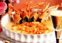 Cigalas con arroz a la crema de naranja