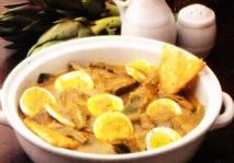 Huevos guisados con alcachofas