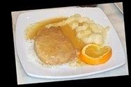 Lomo de cerdo con salsa de naranja y puré de manzanas